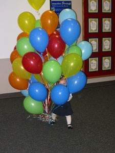 Two Year Old With Balloons