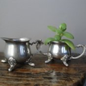 Photo of Silver Creamers on a Table