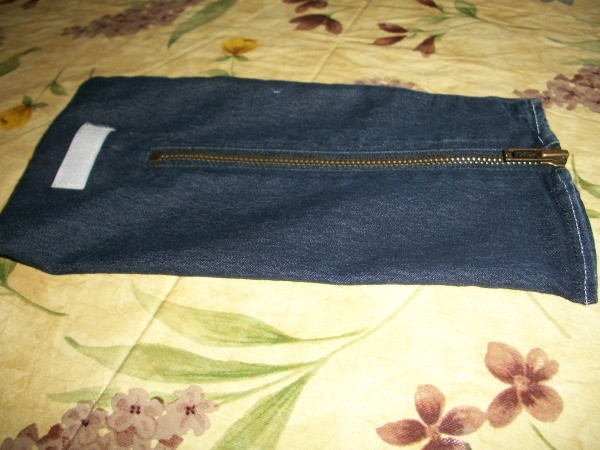 A wrist wallet made out of recycled denim jeans.