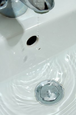 Retrieving Jewelry Dropped in a Sink Drain, Water dripping in bathroom sink