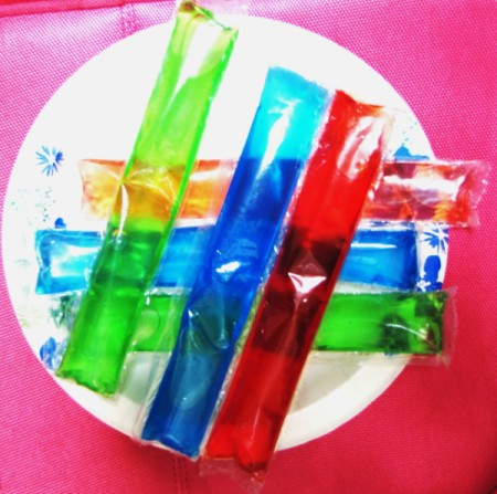 Six colorful ice pops ready for the freezer.