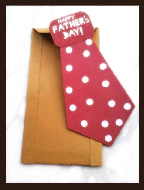 Father's Day red polka dotted tie card with brown envelope.