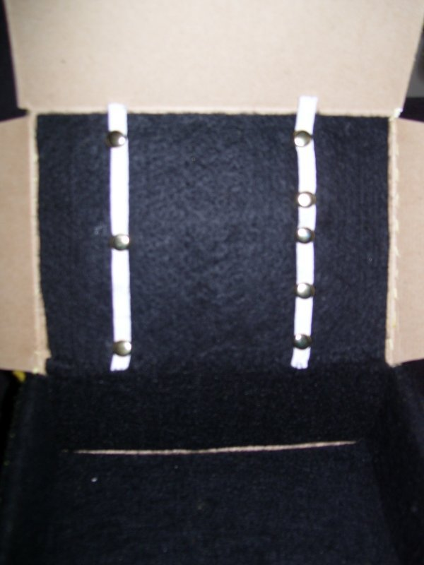 Attaching elastic to the box to hold items.