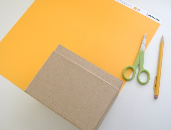 Assorted paper and supplies for Gift House Box.