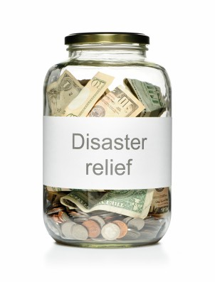 Jar full of money with a disaster relief label on it.