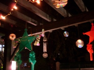 Decorative CDs hanging over a outdoor deck.
