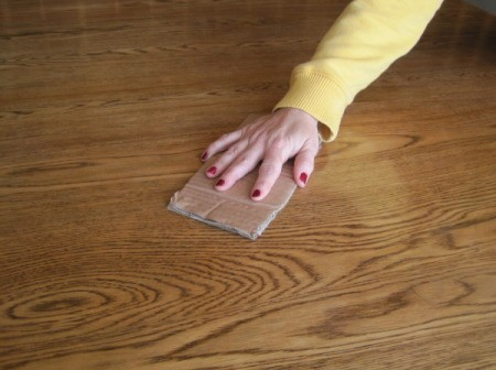 Use a piece of cardboard instead of fine sandpaper on wood.