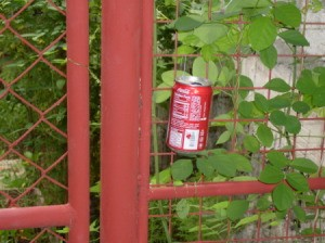 A soda can left for collecting cigarette butts.
