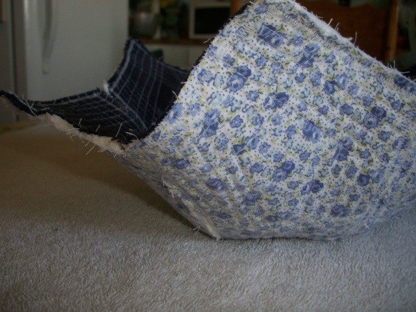 A blue version of a fabric bowl, with denim inside and a blue flowered fabric outside.