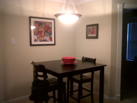 Small dining table in corner of room