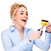 Getting Out of Debt, Picture of a woman cutting a credit card.