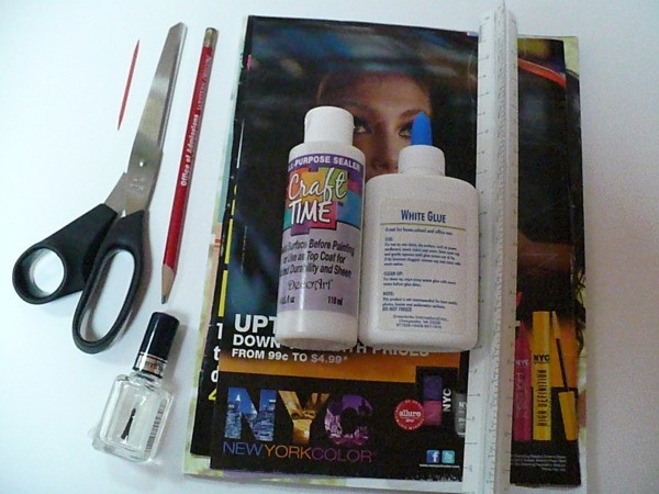 Materials for making beads, magazine, glue, scissors, nail polish, etc.