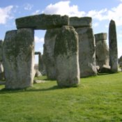 The ancient site of Stonehenge with a cloudy blue sky.