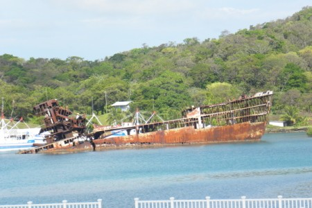 A rusted old shipwreck in Honduras.