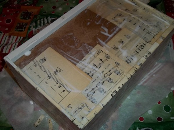 gluing the sheet music onto the bottom of a drawer