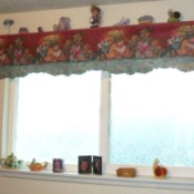 The finished decorative shelf over a frosted window.