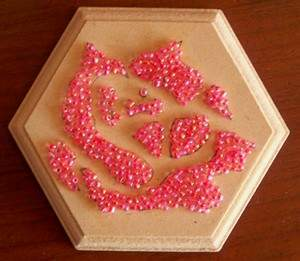 view of box top with pink seed beads glued on in desired pattern