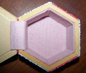 view of inside of box with felt pieces including hinge piece glued in