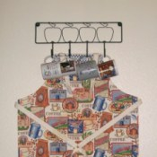 apron hanging on mug rack