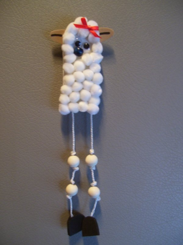white pom pom lamb magnet with red bow on head