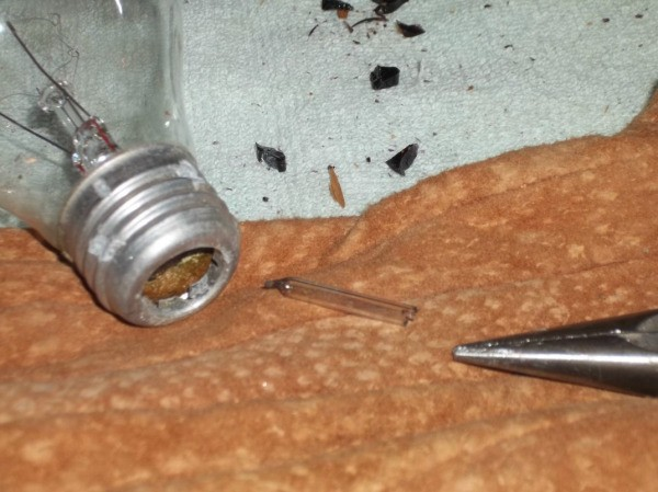 glass tube removed from bulb, lying on towel work surface