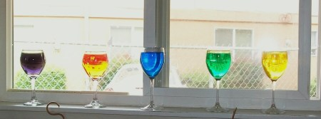 Wine glasses filled with colored water