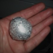 A ball of aluminum foil to prevent static in the dryer.