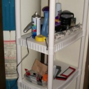 A shelf for extra bathroom and cleaning storage, next to the water heater.