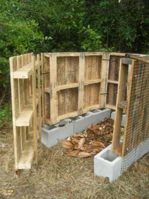 Compost bin made from pallets with door open