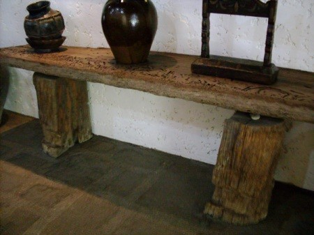 handmade table with base made from two halves of a tree trunk