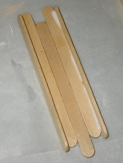 three base sticks with both perpendicular side sticks glued on