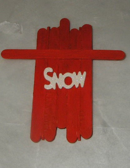 top down view of sled with white letters spelling out snow affixed to top side