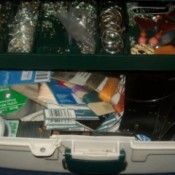 Tackle box filled with jewelery supplies
