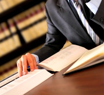 Picture of a lawyer at a desk.