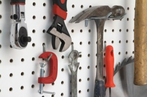 Photo of tools hung a peg board.