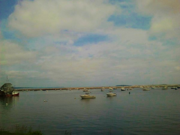 Boats in partly cloudy bay