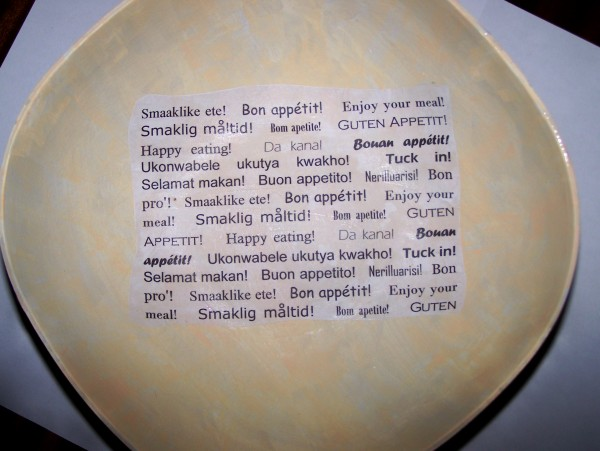 "Bowl with first piece ""word"" paper set in center of bowl interior."