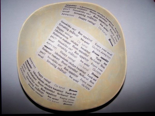 "two more pieces of ""word"" paper added to interior of bowl on upward curving sides."