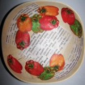 View of interior of bowl with eleven cut outs of bell peppers arranged artfully overlapping each other and the