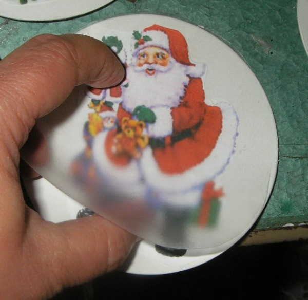 Contact paper being laid on a image of Santa