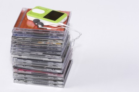 Stack of CDs and an MP3 player on top.