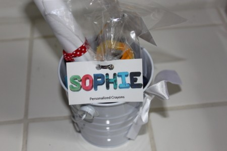 Goodie bag with label showing name in crayons against white background