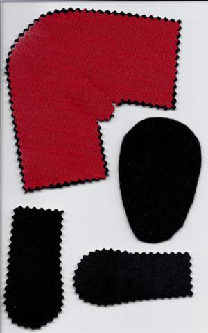 four pieces of bootie pattern cut from felt in red and black