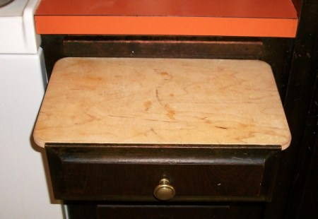 Place a cutting board on top of a seldom used drawer.