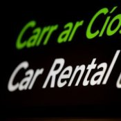 Saving Money on Car Rentals, Neon Car Rental Sign