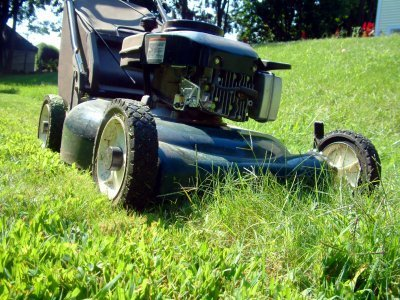 photo of a lawn mower mowing grass
