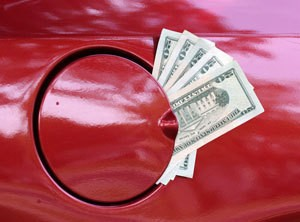 Saving Money on Gas, picture of money coming out of a cars gas tank