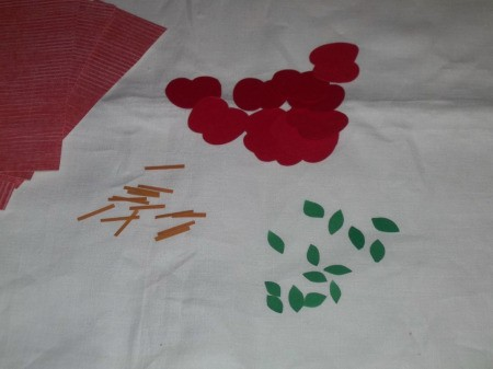 Pieces of cut up red and green paper