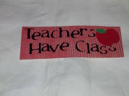 Teachers Have Class written on Red paper with apple