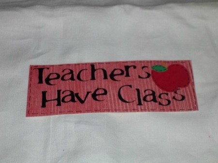 Teachers Have Class written on Red paper with apple 2